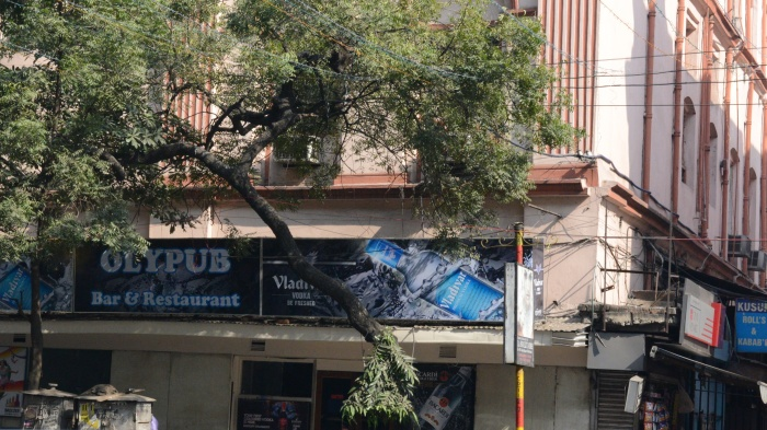 "A Kolkata institution, Olypub where whiskey is poured just little more generously and Kusum Rolls next door, where pimps walk up to you and ask'""Kuch Chahiye saab?"""