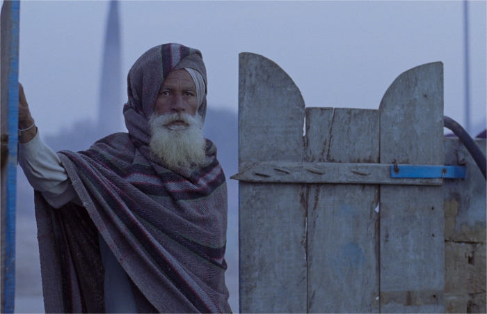 The old man(Mal Singh).His face tells us as much as we want to know about his life.
