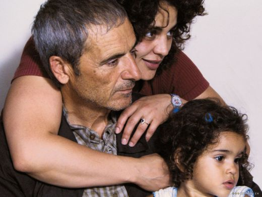 Slimane with one of his daughters and grandchild.