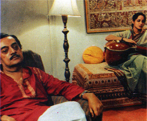 In the living room of the Bose family,Manomohan listens to his niece sing.
