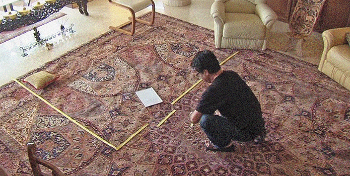 The carpet of Mr Panahi's house is huge, but his protagonists room is very small, so the yellow tape.