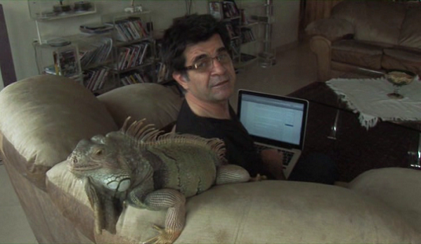 The pet iguana is a supporting actor in a comic role.