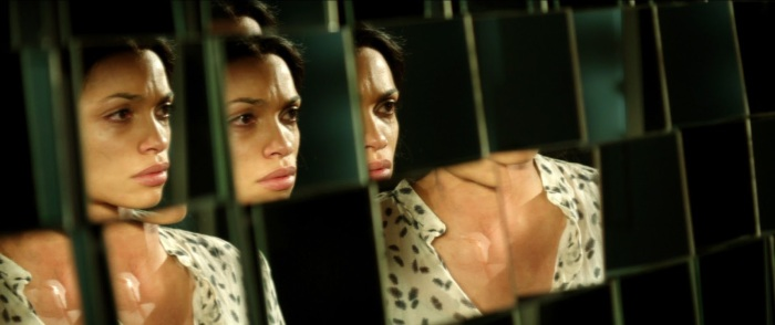 The hypnotic Rosario Dawson as the unlikely femme fatale