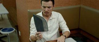 No its not a gun, its his beloved Ah Tiong( pssst!!)